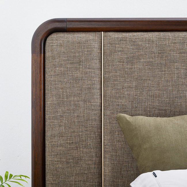 Detail of Silver Lynx Ezra Bedframe in Chocolate stain finish and Nixon Mocha upholstery
