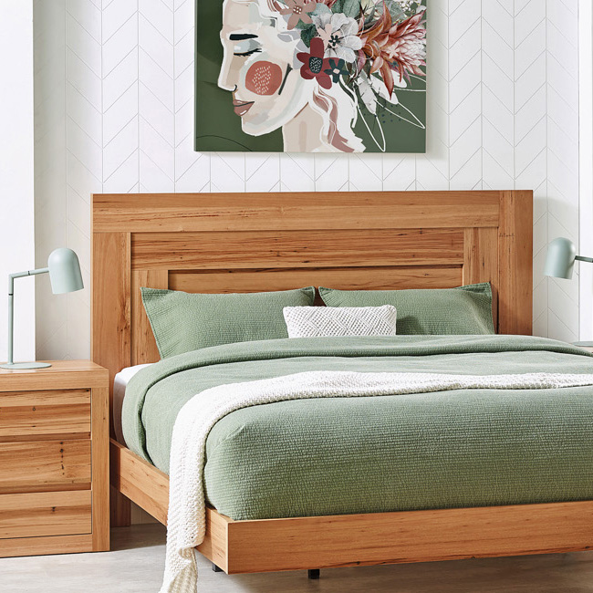 Silver Lynx Montage bed design in natural finish with green covers