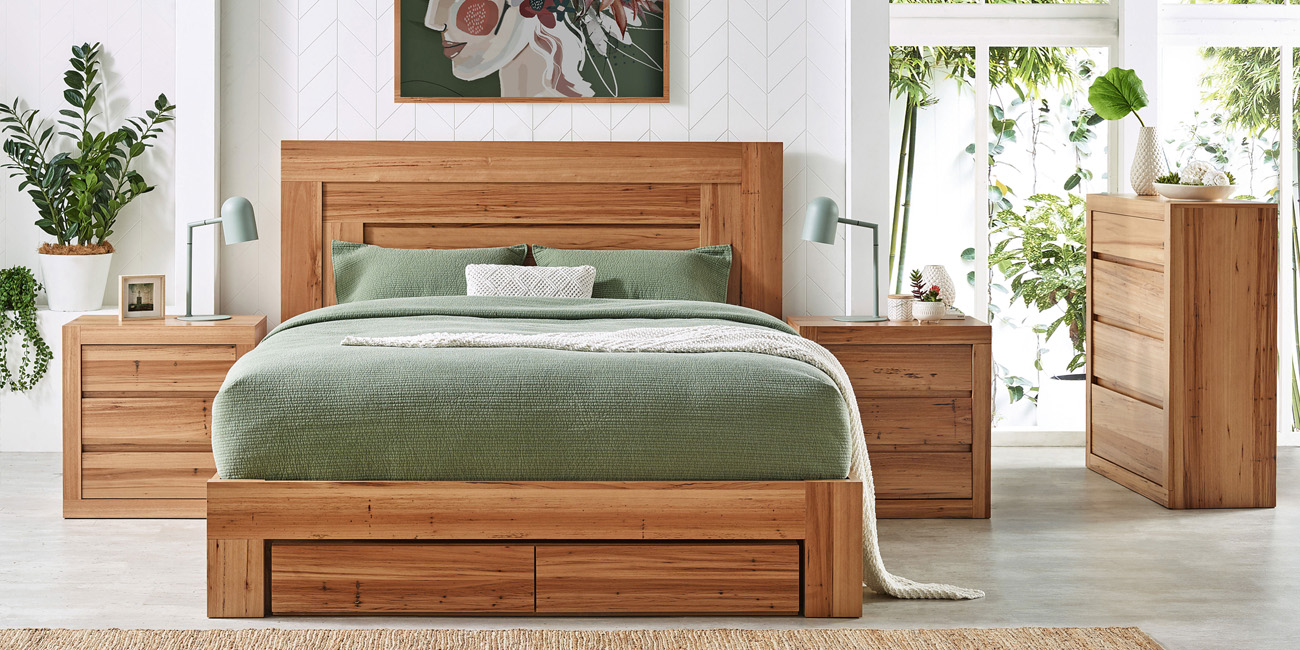 Silver Lynx Montage bed design with storage, green covers and casegoods