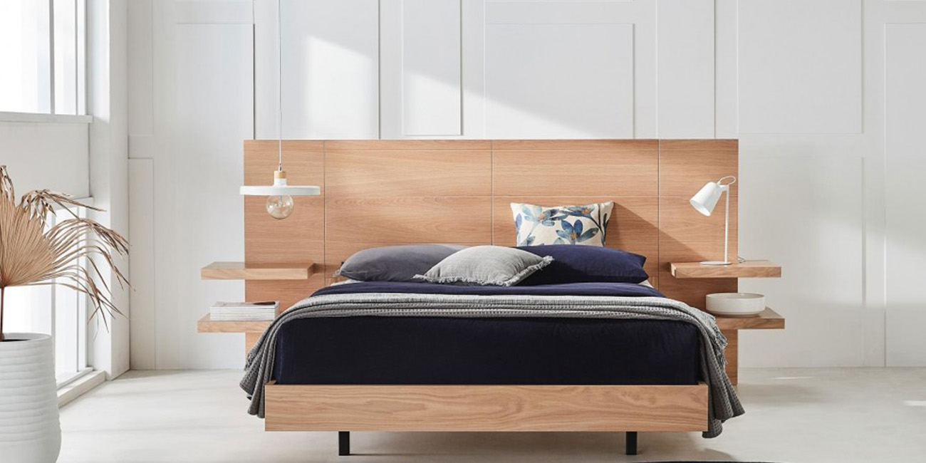 Silver Lynx Hugo bed design with deep purple doona, front on view